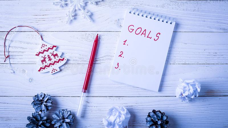 Workplace with a diary, decorations and gifts. New Year`s list o stock photos