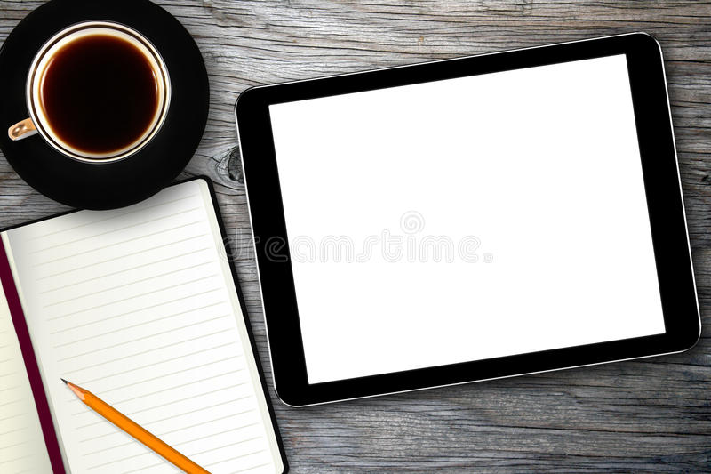 Workplace with digital tablet and coffee cup stock image