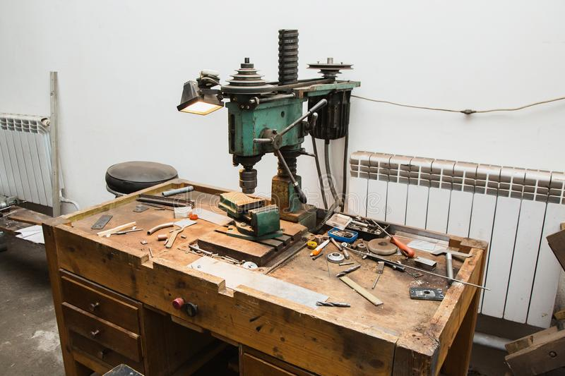 Do a house repair. Tools for repair. Workplace with a drill and vice. Work at a factory. Drilling Machine stock photo