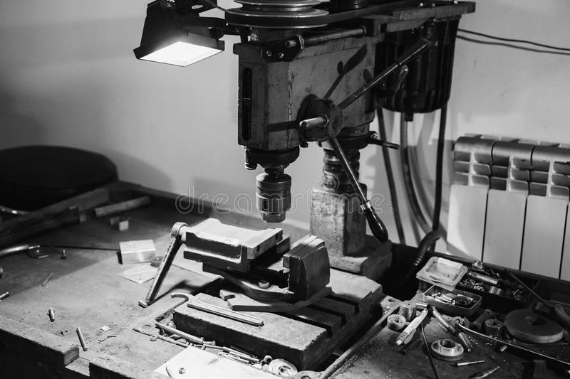 Lack and white art monochrome photography. Workplace with a drill and vice. Work at a factory. Drilling Machine royalty free stock image