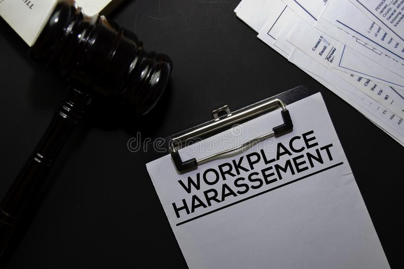 Workplace Harassement text on Document and gavel  on office desk. Law concept royalty free stock photography