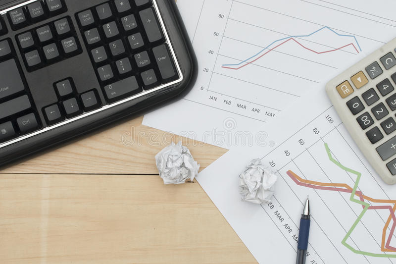 Download Workplace With Keyboard, Graph, Calculator, And Pan On Wood Table Stock Image - Image: 83707325
