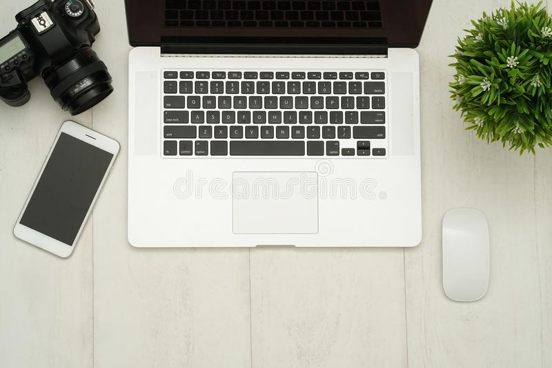 Workplace with notebook laptop Comfortable work table in office royalty free stock photo