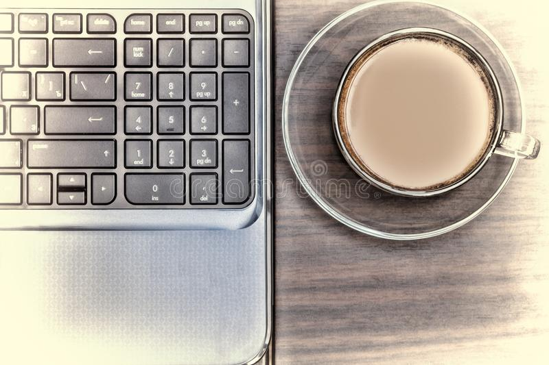 Workplace in the office. Note-book and a cup of coffee. Working space. Concept: office, business royalty free stock images