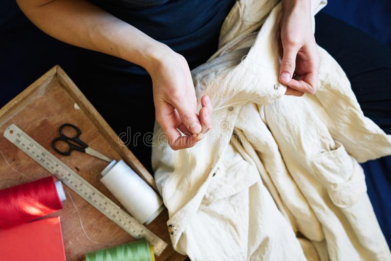 Workplace of seamstress. Dressmaker makingdetail, sew on buttons, spools of thread, tailor shop, tailoring, close up royalty free stock photos