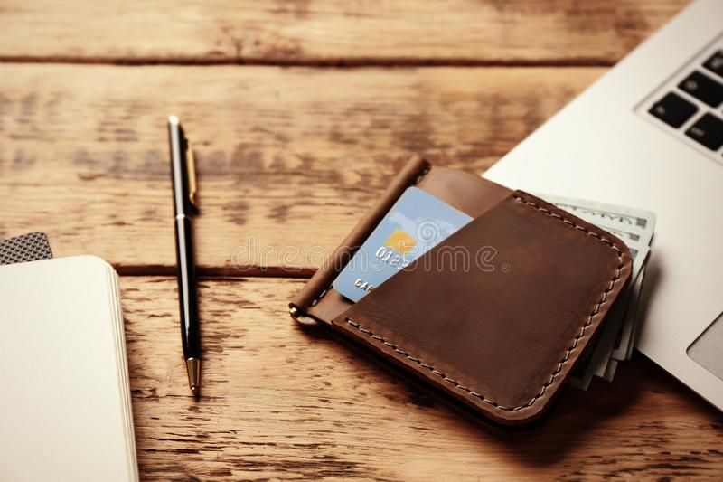 Workplace with stylish leather wallet. And laptop royalty free stock images