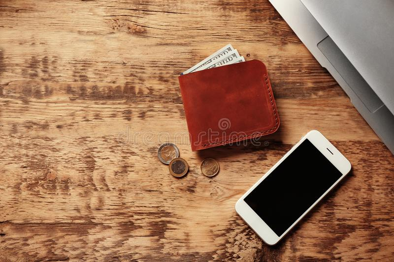 Workplace with stylish leather wallet. And smartphone stock photos