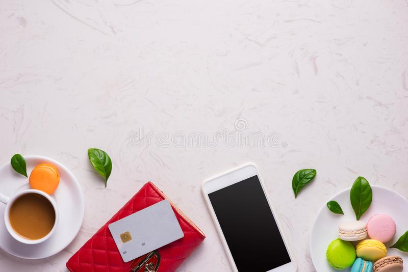 Workplace with stylish red leather wallet and smartphone.  stock images
