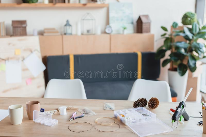 Workplace with tools for handmade accessories manufactoring. At workshop royalty free stock photo