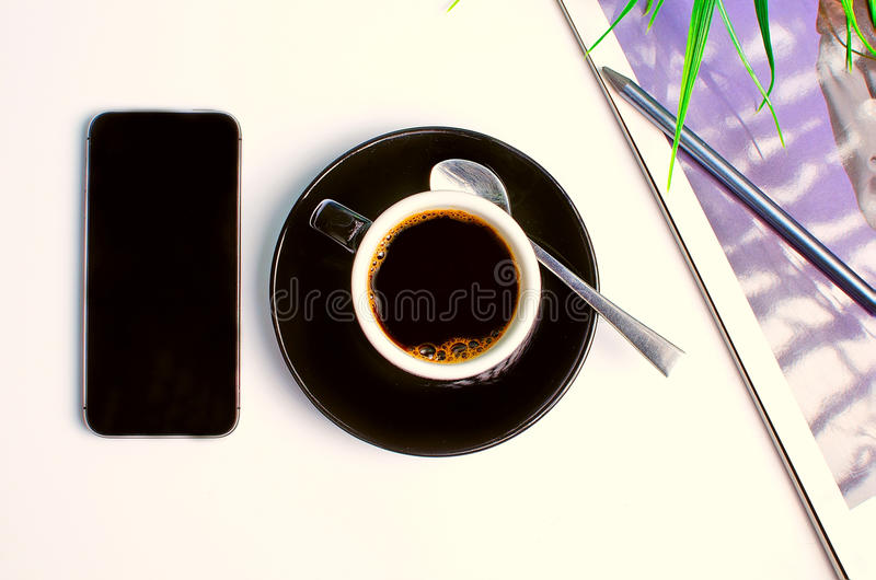 Workplace on top with coffee and phone royalty free stock photo
