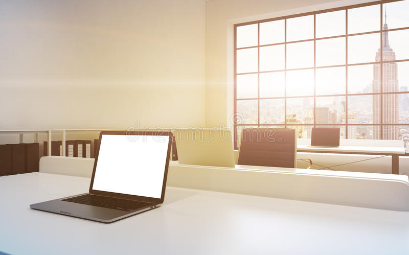 Workplaces in a bright modern loft open space office. Tables equipped with laptops, white copy space in the screen. Docs shelves. royalty free illustration