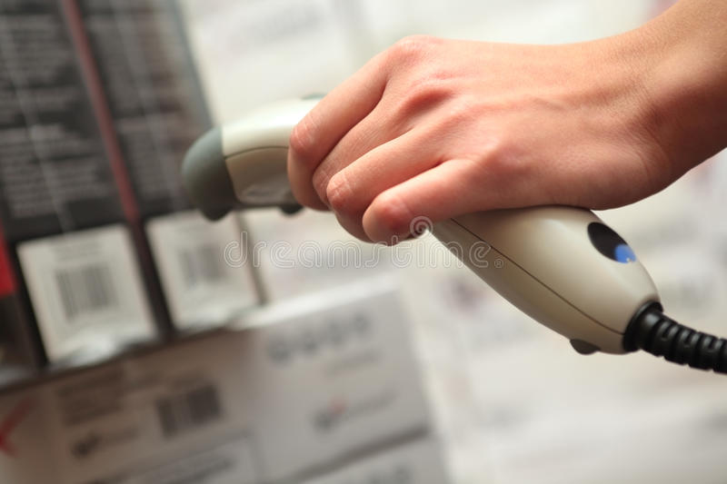 Download She Works With Barcode Reader Stock Photo - Image: 12062652