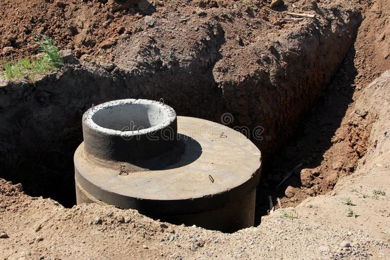 Works on installation of the sewerage on a building site. royalty free stock photography