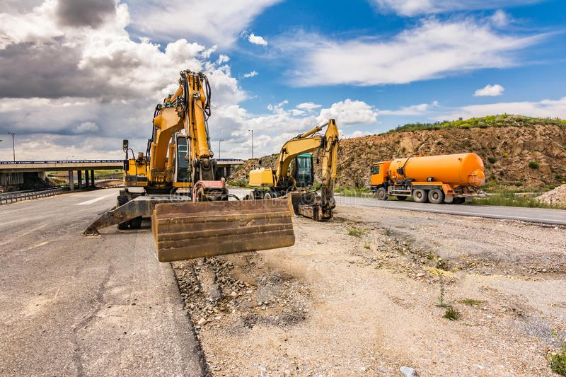 Works of repair and expansion of a road with different heavy machinery stock photos