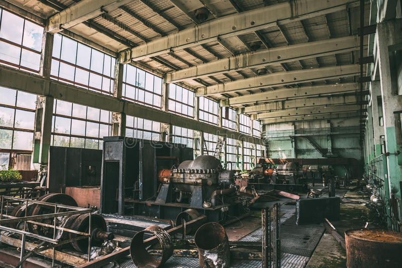 Workshop of abandoned metallurgical factory inside interior with equipment. Demolition concept stock photography