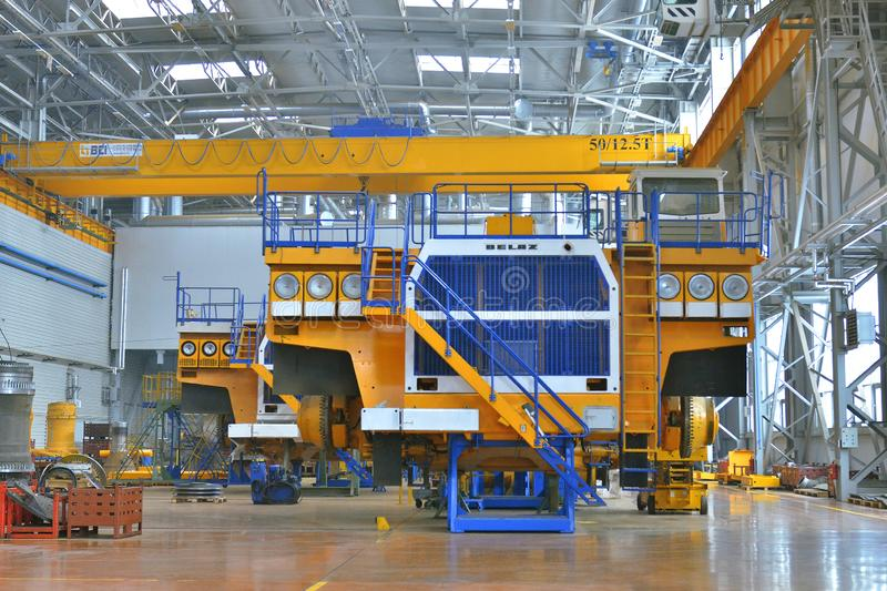 Workshop assembly of large dump trucks. Mining dump truck manufacturing plant. Workshop assembly of large dump trucks stock photography