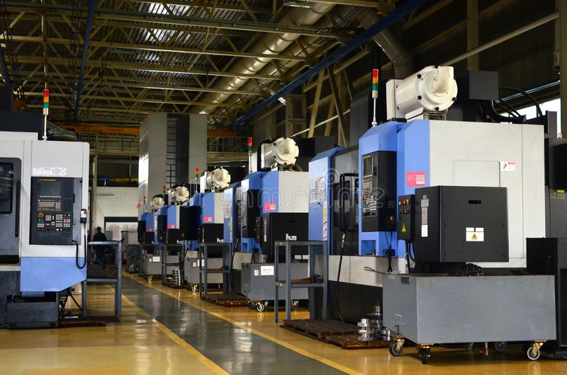 Workshop of a automotive factory with automatic CNC turning machines. High precision CNC plasma aluminum plasma cutter computerized machines iron. Oxygen torch royalty free stock image