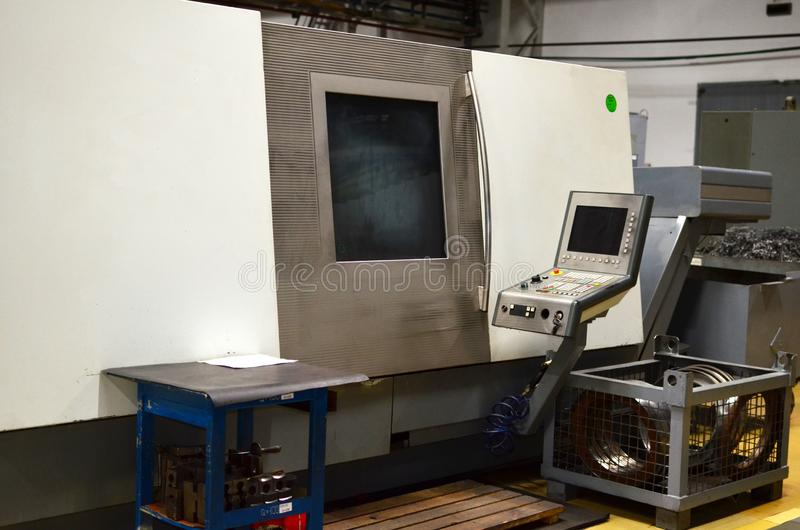 Workshop of a automotive factory with automatic CNC turning machines. High precision CNC plasma aluminum plasma cutter computerized machines iron. Oxygen torch stock photography