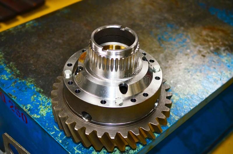 Workshop of a automotive factory for the production of automotive gear, spare parts and components. Production of gears for automobile gearboxes for trucks stock image