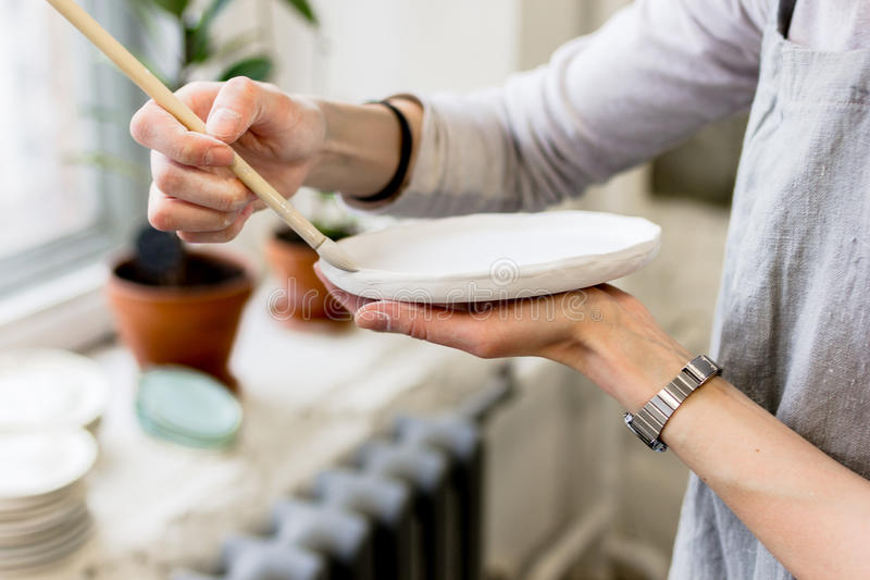 Workshop production of ceramic tableware product painting.  royalty free stock photos