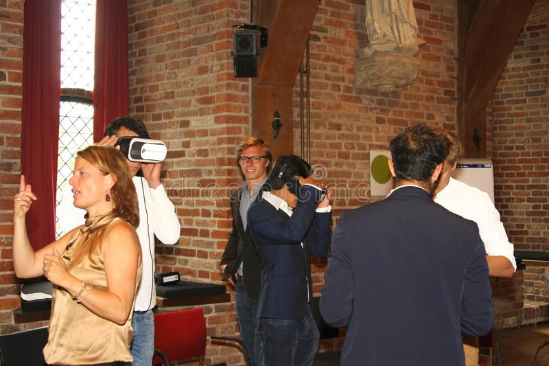 Workshop training virtual reality, Netherlands. Young people experience virtual reality glasses during a workshop in the castle of Nyenrode University in stock photos
