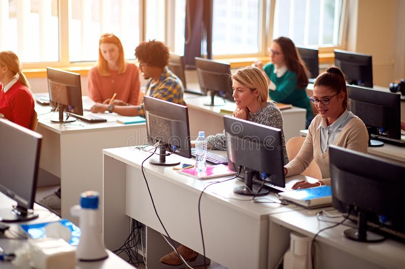 IT workshop at university. Group of Students on class with computer stock photo