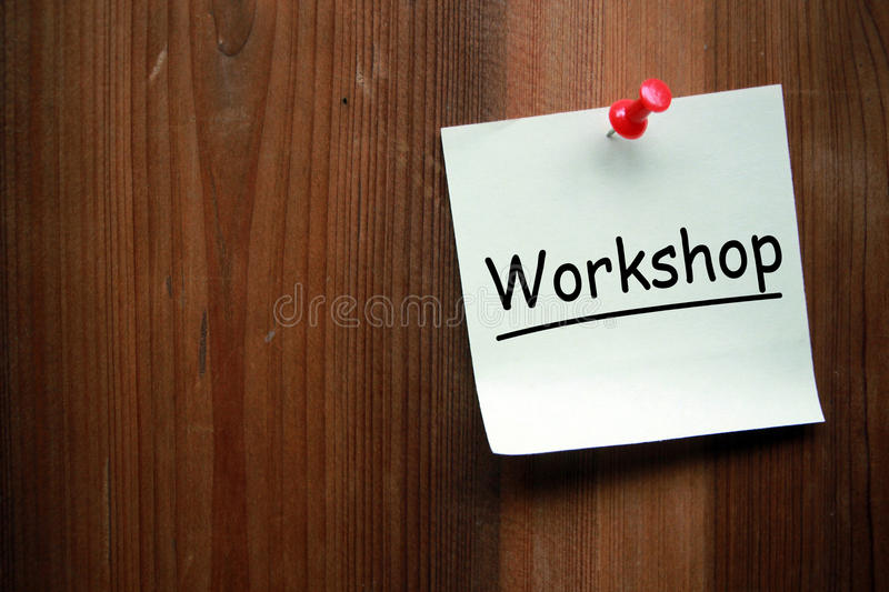 Workshop. Written on note with wooden background stock photo