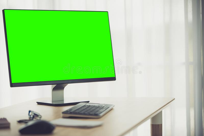 Workspace background with desktop pc and office accessories . Workspace background with desktop pc and office accessories on table, Green screen on monitor stock image