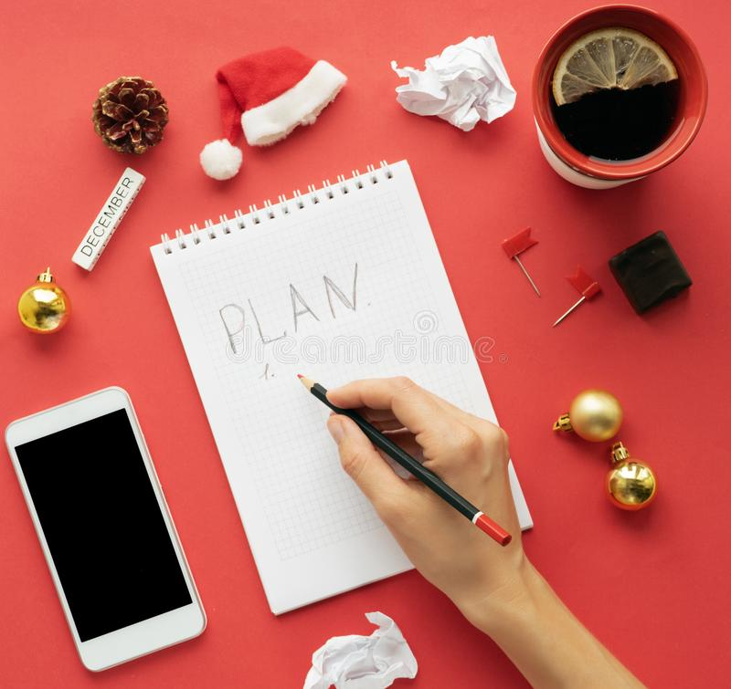 Workspace on Christmas Eve and New Year, preparation for the holiday and gift list. with blank clip board, keyboard stock photos