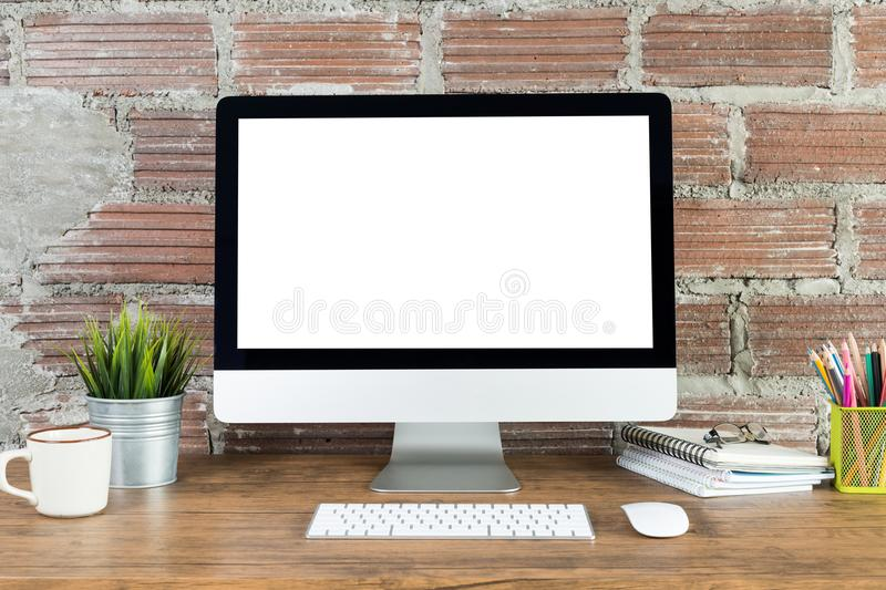 Workspace with computer with blank white screen stock photos