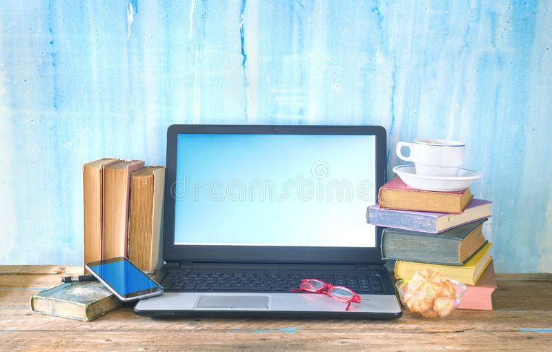 Workspace of a creative person, books, laptop, smartphone, creativity business mockup, copy space stock image