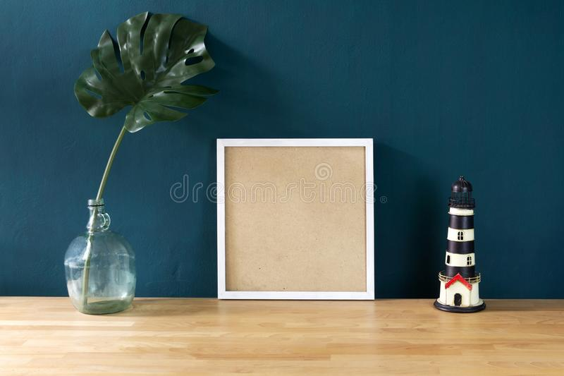 Workspace decoration with white photo frame and tropical monster stock photography