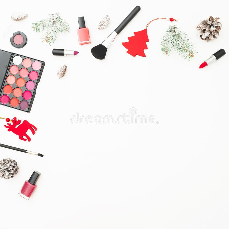Workspace desk with woman cosmetics, accessories and Christmas decoration on white background. Flat lay, top view. Beauty backgrou royalty free stock images