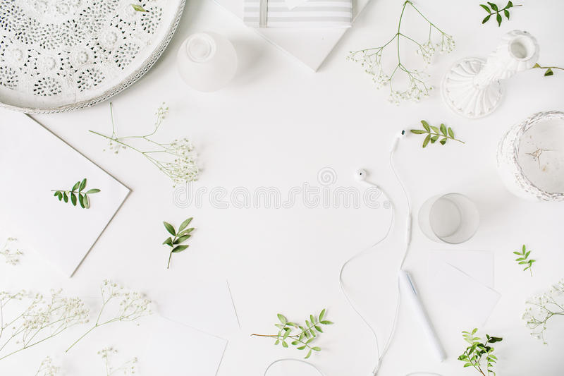 Workspace with headphones, pen, notebook, sketchbook, white vintage tray, candlesticks on white background royalty free stock photos