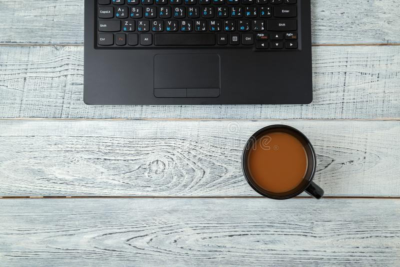Workspace . laptop and Cup of coffee. minimalism. the view from the top. flat lay royalty free stock photo
