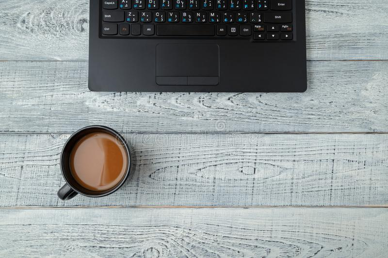 Workspace . laptop and Cup of coffee. minimalism. the view from the top. flat lay royalty free stock photos
