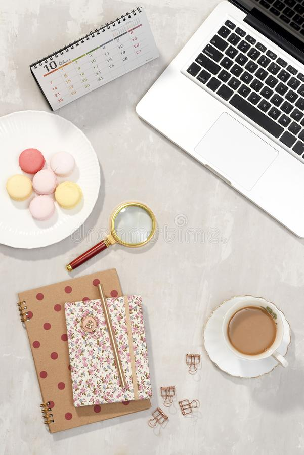 Top view feminine office table desk. Freelancer working place stock photo