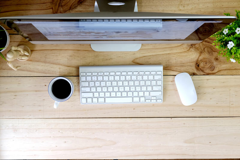 Workspace modern desktop computer on wood table and office stuff. stock images