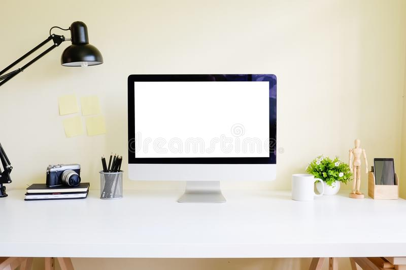 Workspace office table with Pc computer mockup display on white. Table stock photos
