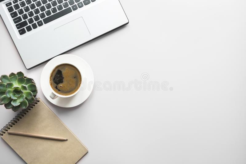 Open laptop, planning and cup of coffee. Top view with copy space. Office business concept. Working process. Workspace with open laptop, documentation, and cup royalty free stock photo