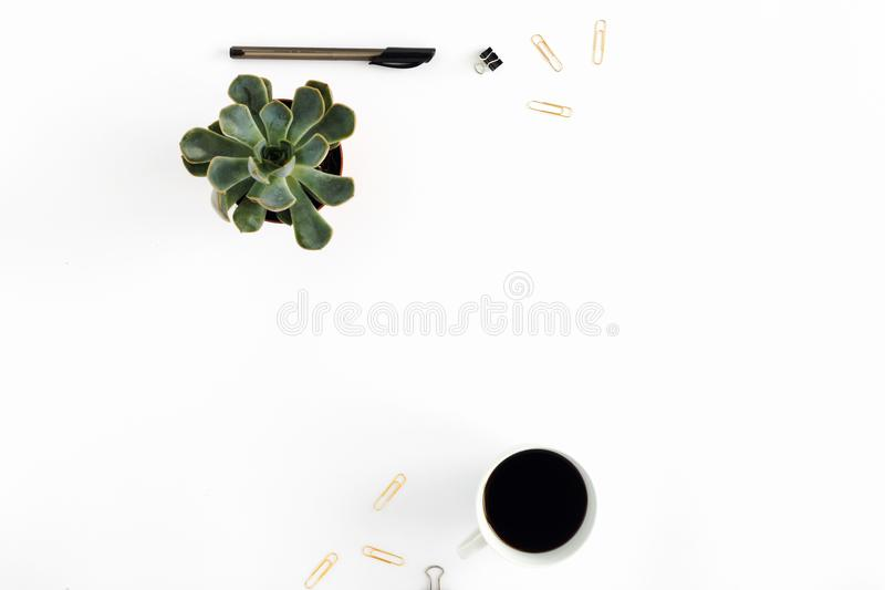 Workspace pattern with coffee, succulent, pen, golden clips. fla stock photo
