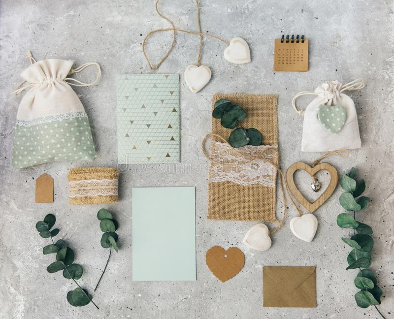 Workspace. Wedding invitation card and eucalyptus leaves on white background. royalty free stock photo