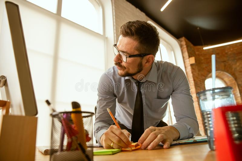 A young businessman moving in office, getting new work place stock photo