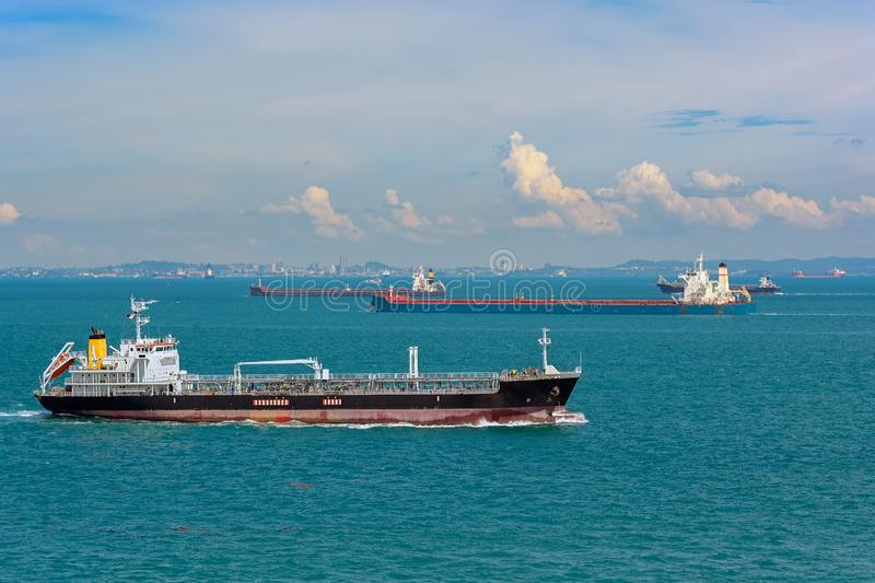 World's busiest shipping lane - Straits of Malacca and Singapore. Congested traffic in the narrow passageway in the Straits of Malacca and Singapore, the stock photos