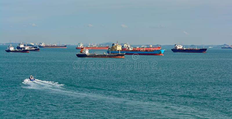 World's busiest shipping lane - Straits of Malacca and Singapore. Congested traffic in the narrow passageway in the Straits of Malacca and Singapore, the royalty free stock photos
