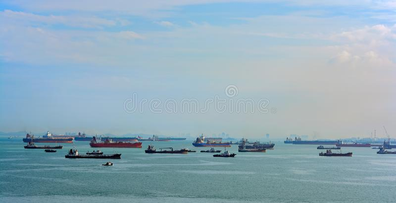 World's busiest shipping lane - Straits of Malacca and Singapore. Congested traffic in the narrow passageway in the Straits of Malacca and Singapore, the stock photography
