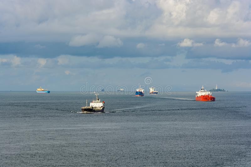 World's busiest shipping lane - Straits of Malacca and Singapore. Congested traffic in the narrow passageway in the Straits of Malacca and Singapore, the royalty free stock images