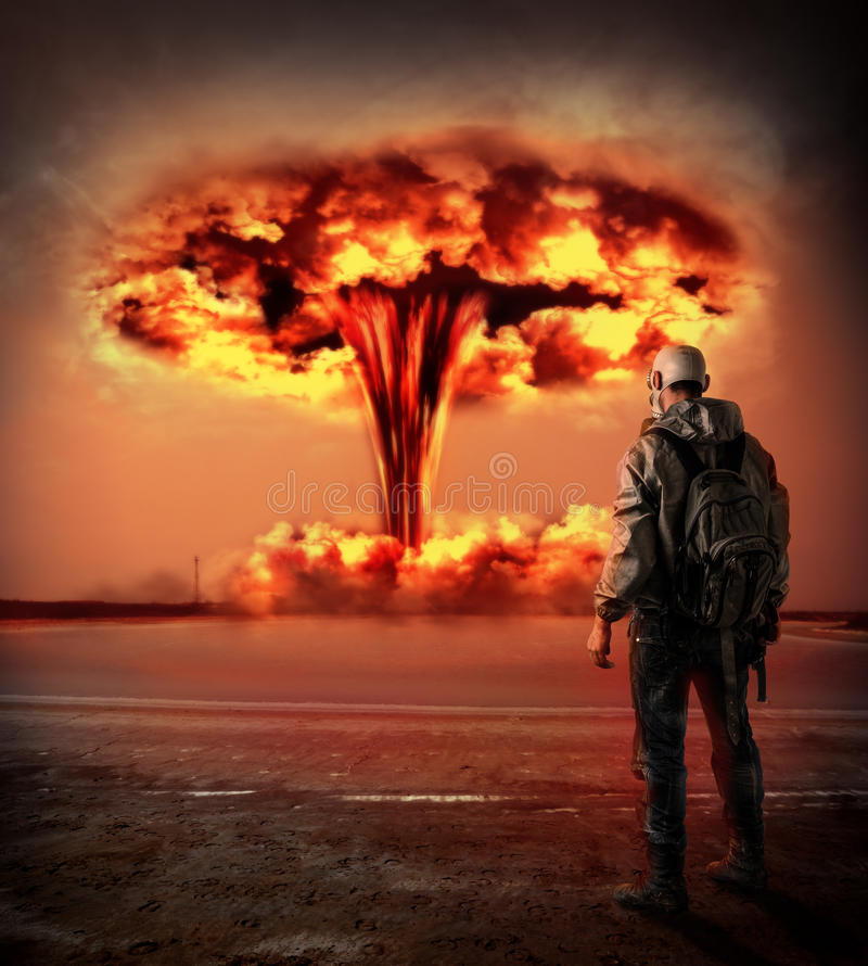 World Apocalypse. Nuclear explosion outdoor. World Apocalypse. Man in gas looking on big red mushroom of Nuclear explosion outdoor. environmental protection stock image