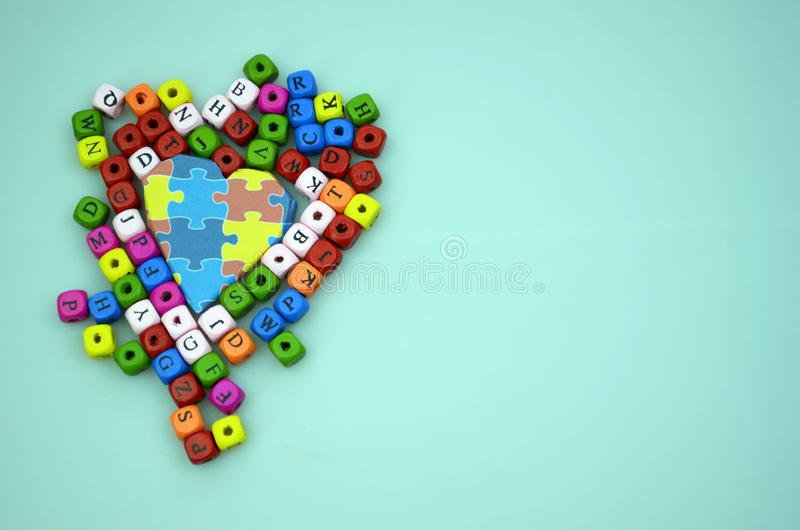 World Autism Awareness day. World Autism Awareness day, mental health care concept with puzzle pattern on heart and colored wooden cubes, copy space stock image