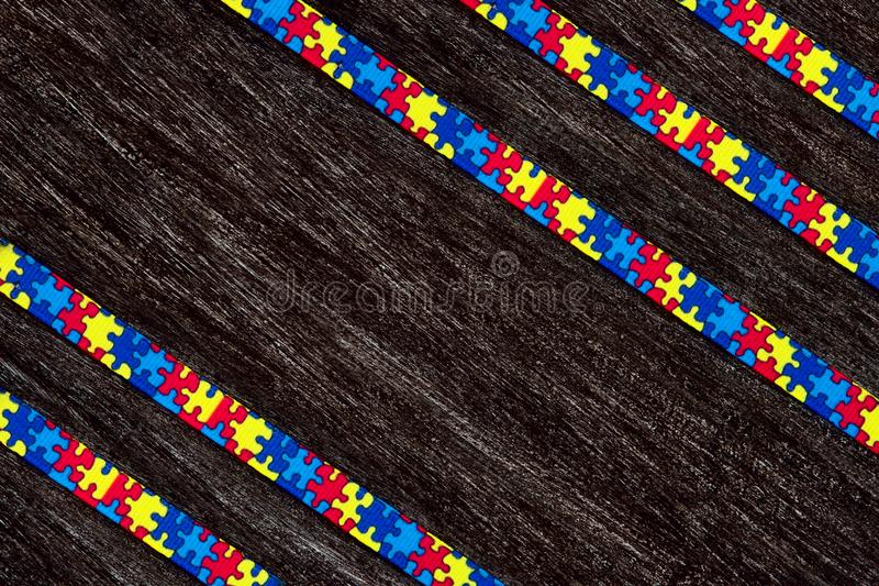 World Autism awareness day with Puzzle ribbon on wooden background stock photos